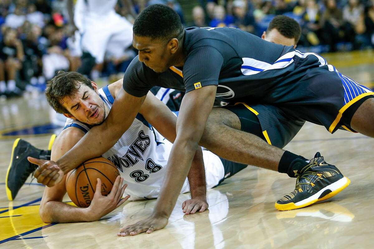 Minnesota Timberwolvesforward Nemanja Bjelica (88) and Golden State Warriors forward Kevon Looney (5) battle for the basketball during the first half of an NBA basketball game between the Golden State Warriors and the Minnesota Timberwolves at the Oracle Arena on Saturday, Nov. 26, 2016 in Oakland, Calif. The Warriors lead at half time 56-48. Referees called a jump ball.