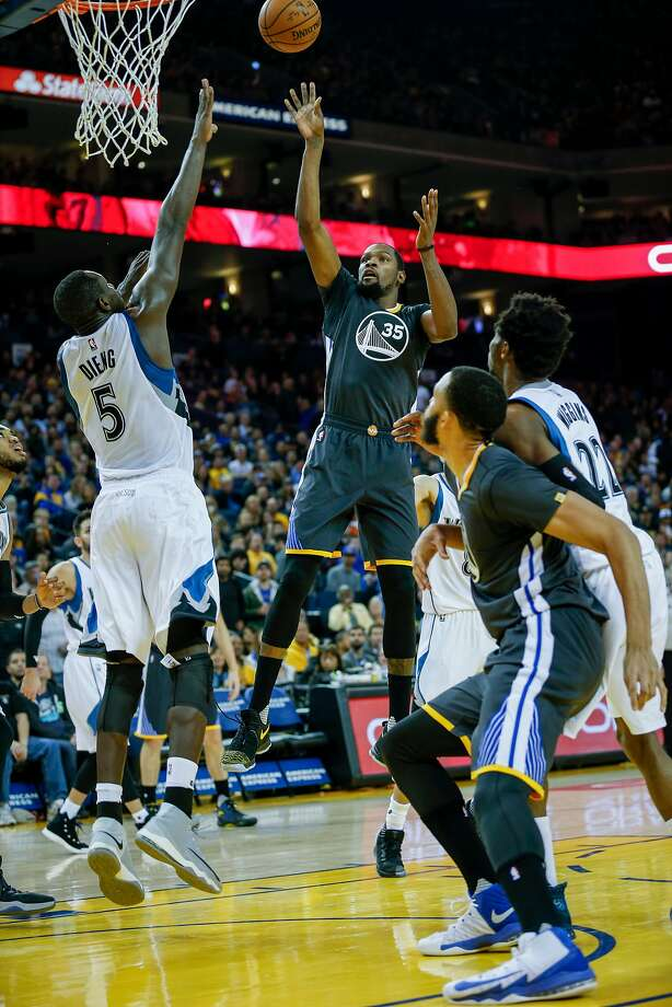 Warriors forward Kevin Durant (35) shoots over Timberwolves forward Gorgui Dieng during the first half. Photo: Santiago Mejia, The Chronicle