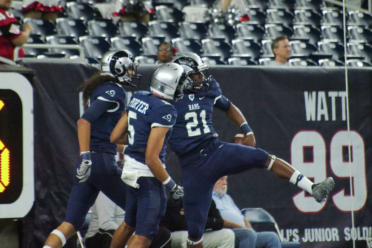 Nov. 26: Cypress Ridge 49, Clear Brook 14 Cy-Ridge's Alex Jacobs (21) celebrates after scoring a touchdown against Clear Brook in the first half Saturday, Nov. 26 at NRG Stadium in Houston, Texas.