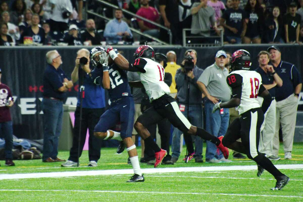 Cy-Ridge's Kevin LeDee (12) pulls down a pass over Clear Brook's Braelon Hill (11) in the first half Saturday, Nov. 26 at NRG Stadium in Houston, Texas.