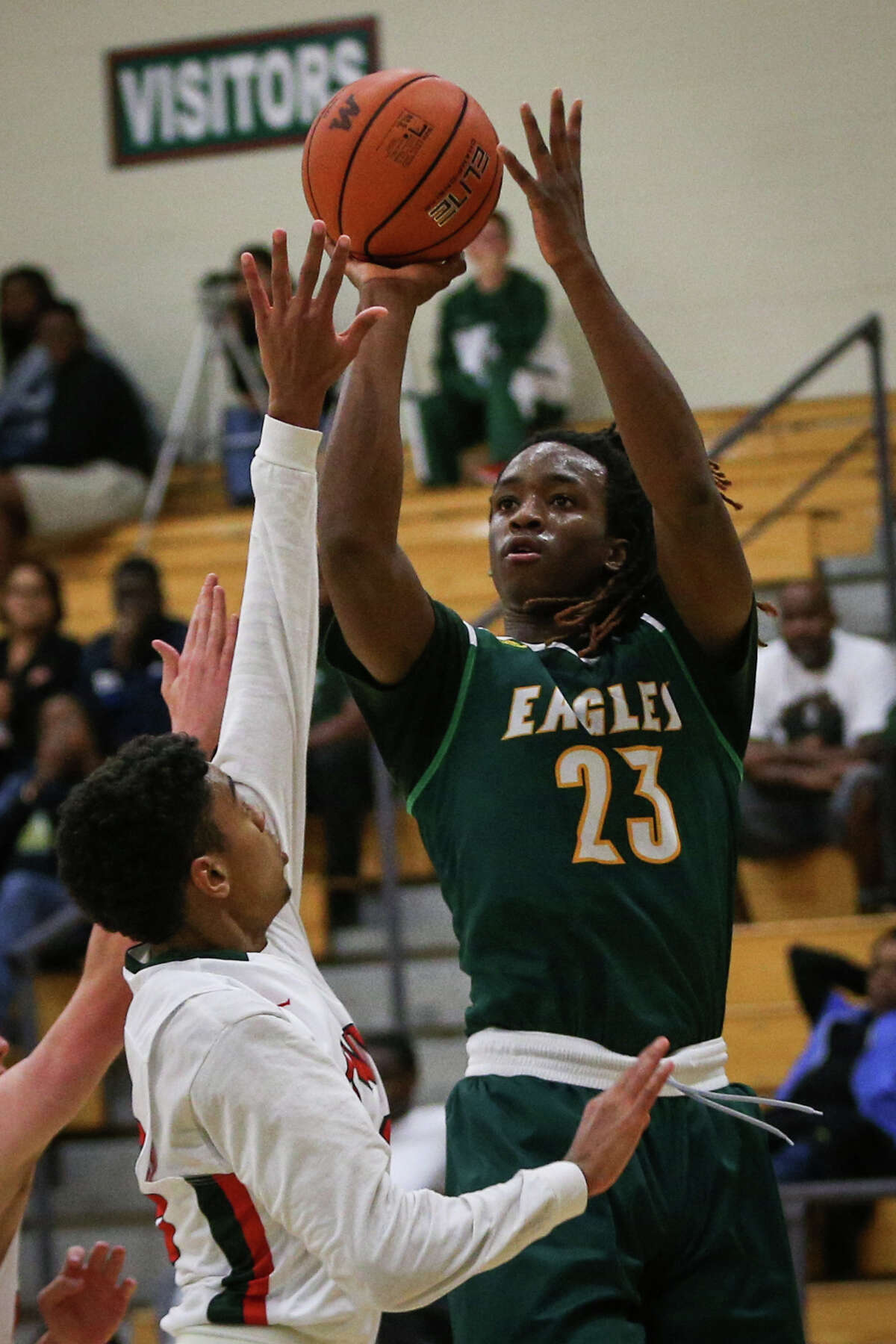 Klein Forest's Cedrick Alley (23) shoots as The Woodlands' Sammy Williams (30) defends during the varsity boys basketball game on Saturday, Nov. 26, 2016, at The Woodlands High School. (Michael Minasi / Chronicle)