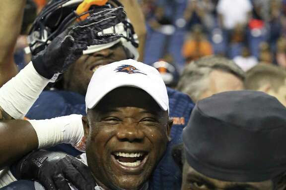 UTSA coach Frank Wilson celebrates with his players after the win over Charlotte to clinch a bowl berth.