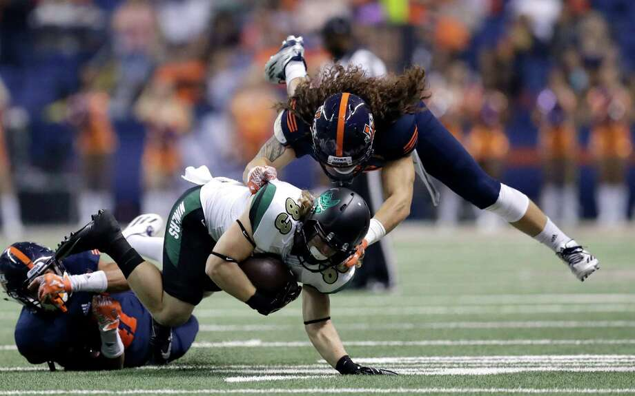 Charlotte wide receiver Nate Mullen (83) is hit by UTSA linebacker Josiah Tauaefa (55) during the first half of an NCAA college football game, Saturday, Nov. 26, 2016, in San Antonio. (AP Photo/Eric Gay) Photo: Eric Gay, Associated Press / Copyright 2016 The Associated Press. All rights reserved.