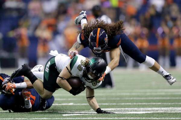 Charlotte wide receiver Nate Mullen (83) is hit by UTSA linebacker Josiah Tauaefa (55) during the first half of an NCAA college football game, Saturday, Nov. 26, 2016, in San Antonio. (AP Photo/Eric Gay)