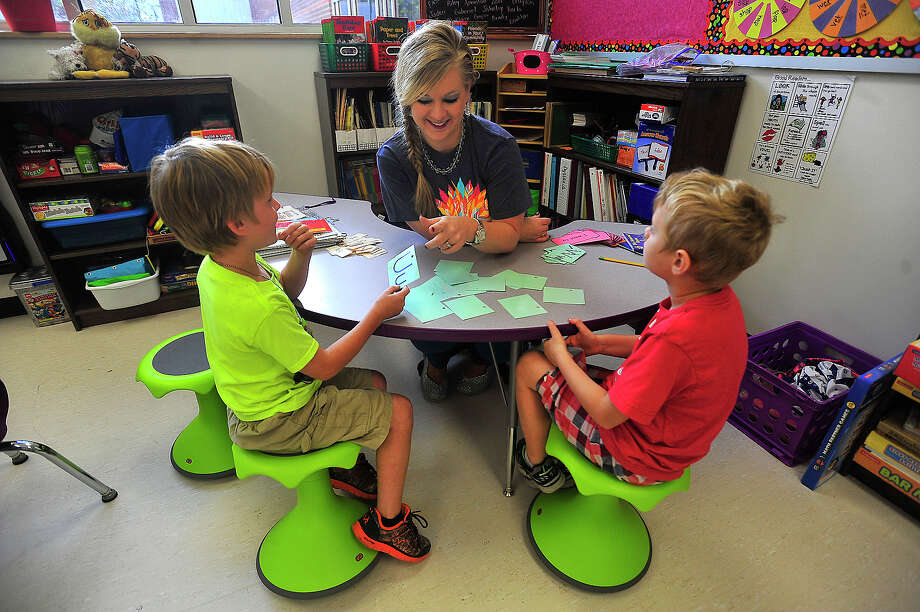 Silsbee Elementary first graders Brady Tatom, 7, (left) and Morgan Brown, 7, balance on their wobble chairs while doing a reading lesson with teacher Jill Tarkington. The chairs are part of the new furniture the school got for their new building. Photo taken Thursday, November 3, 2016 Kim Brent/The Enterprise Photo: Kim Brent / Beaumont Enterprise