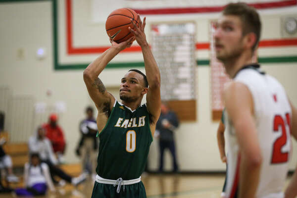 Klein Forest's Kenneth Morris (0) shoots a free throw during the varsity boys basketball game against The Woodlands on Saturday, Nov. 26, 2016, at The Woodlands High School. (Michael Minasi / Chronicle)