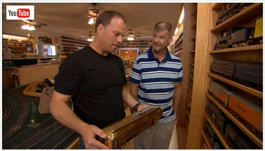 "James Hall, right, was featured on the show ""Extreme Collections"" with his massive train display in his home in Virginia. Hall has spent his lifetime gathering a massive collection of American made antique trains but has yet to see any money from the Danbury based Nette Auctions that he hired to sell the collection. State and local officials are investigating several similar complaints against the company. Photo: YouTube / Contributed / The News-Times Contributed"