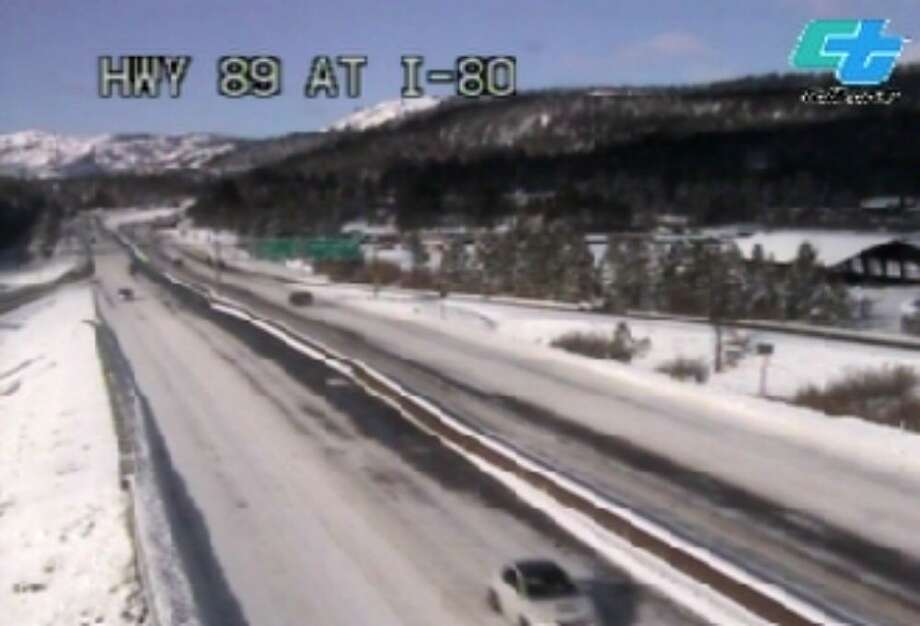 A Caltrans traffic camera shows Interstate 80 near Truckee where morning snow prompted chain controls. Photo: Caltrans / /