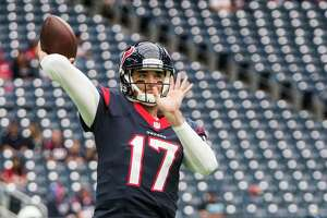 Houston Texans quarterback Brock Osweiler warms up before an NFL football game against the San Diego Chargers at NRG Stadium on Sunday, Nov. 27, 2016, in Houston.