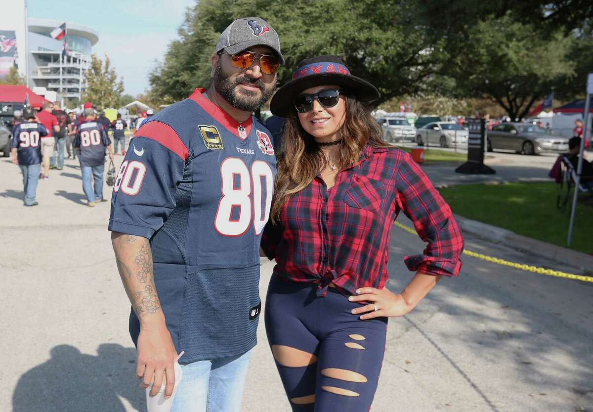 Houston Texans fans pose for a photo at the NRG Stadium parking lot before the team takes on San Diego Chargers Sunday, Nov. 27, 2016, in Houston.