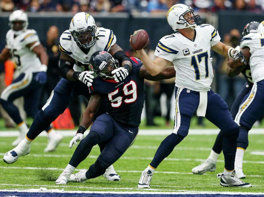 San Diego Chargers quarterback Philip Rivers (17) gets off a pass as he is pressured by Houston Texans outside linebacker Whitney Mercilus (59) during the second quarter of an NFL football game at NRG Stadium on Sunday, Nov. 27, 2016, in Houston. Photo: Brett Coomer, Houston Chronicle / © 2016 Houston Chronicle