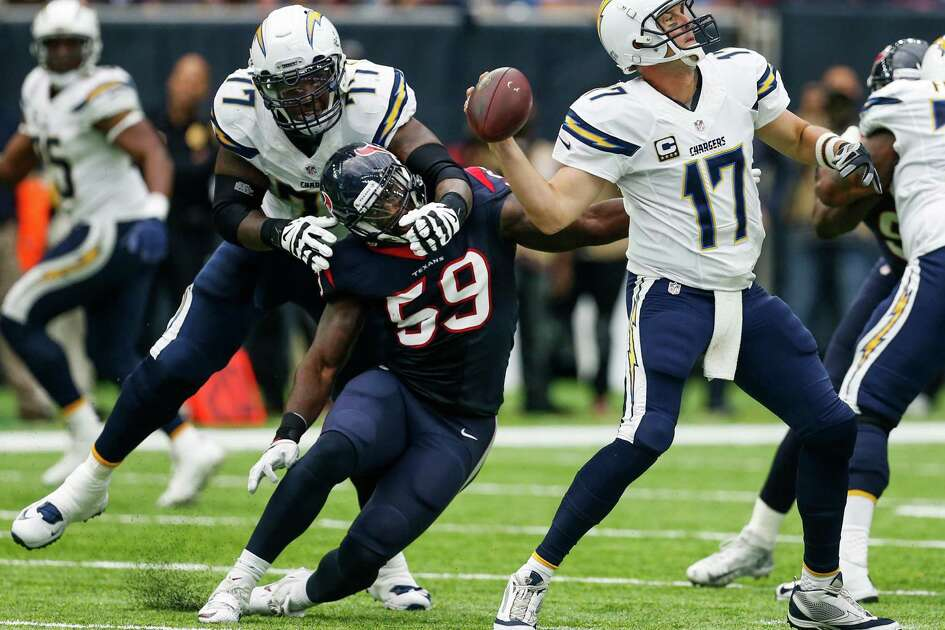 San Diego Chargers quarterback Philip Rivers (17) gets off a pass as he is pressured by Houston Texans outside linebacker Whitney Mercilus (59) during the second quarter of an NFL football game at NRG Stadium on Sunday, Nov. 27, 2016, in Houston.
