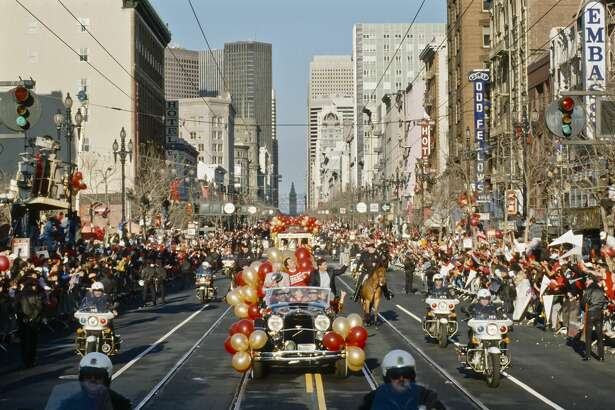 SAN FRANCISCO - JANUARY 23: San Francisco 49ers Head Coach Bill Walsh, Mayor of San Francisco Art Agnos, and 49ers team owner Eddie DeBartolo wave to the crowd during the Super Bowl Parade on Market Street in San Francisco, California on January 23, 1989.  The 49ers won Super Bowl XXIII in a victory over the Cincinnati Bengals. (Photo by David Madison/Getty Images)