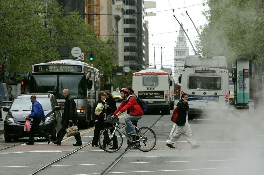 A plan to restrict private vehicles from using a large stretch of Market Street was approved by SFMTA Tuesday afternoon; several planned improvements to the street are set to begin in early 2020 and will proceed in stages. Photo: Justin Sullivan/Getty Images