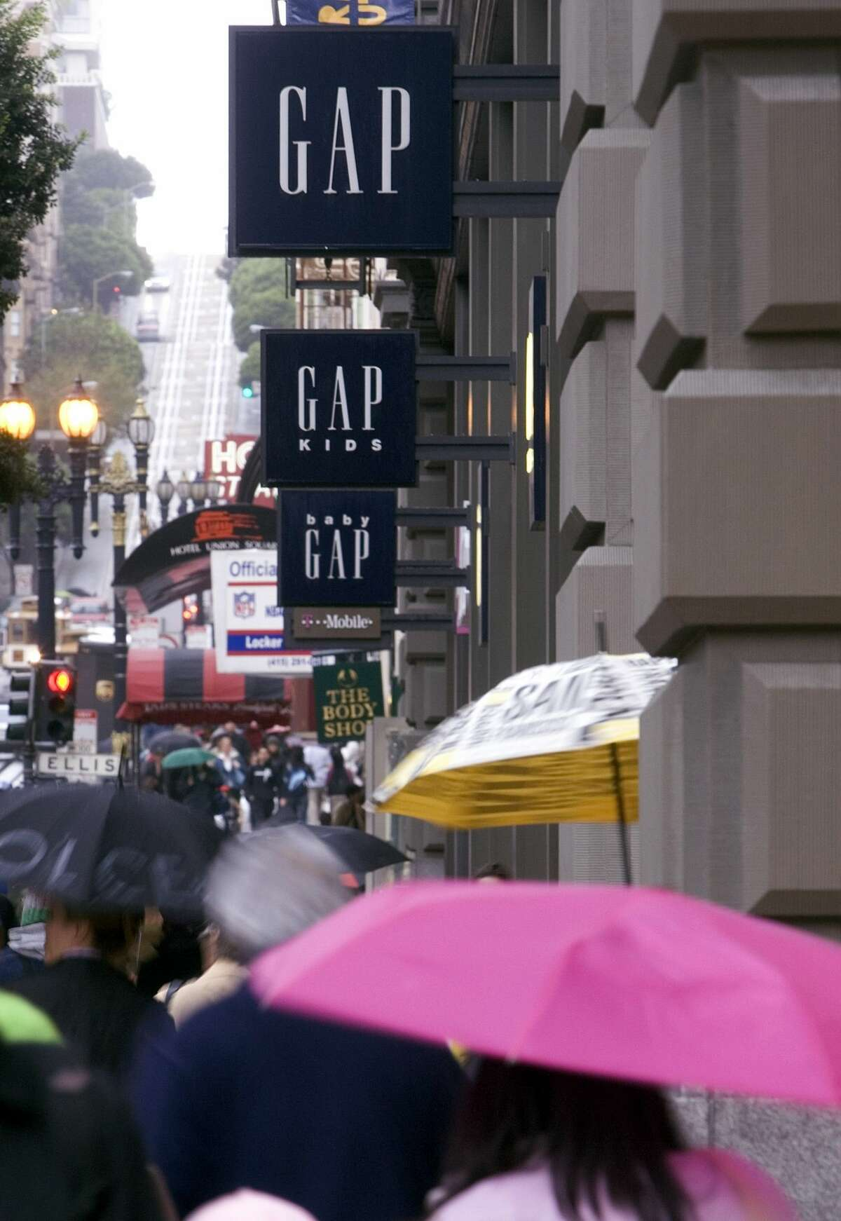People walk past the Gap store on Market street and Powell street on November 2, 2006 in San Francisco, California. Gap has recently posted a drop in same-store sales at 7 percent for the month of October.
