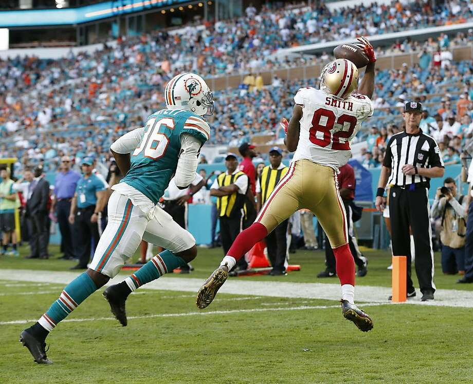 Torrey Smith (82) grabs a pass for a touchdown in the fourth quarter as the 49ers attempted to stage a comeback in Miami. Photo: Wilfredo Lee, Associated Press
