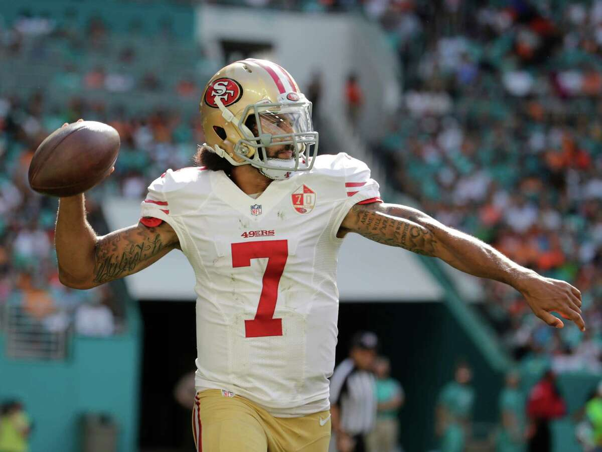 San Francisco 49ers quarterback Colin Kaepernick (7) looks to pass, during the first half of an NFL football game against the Miami Dolphins, Sunday, Nov. 27, 2016, in Miami Gardens, Fla.