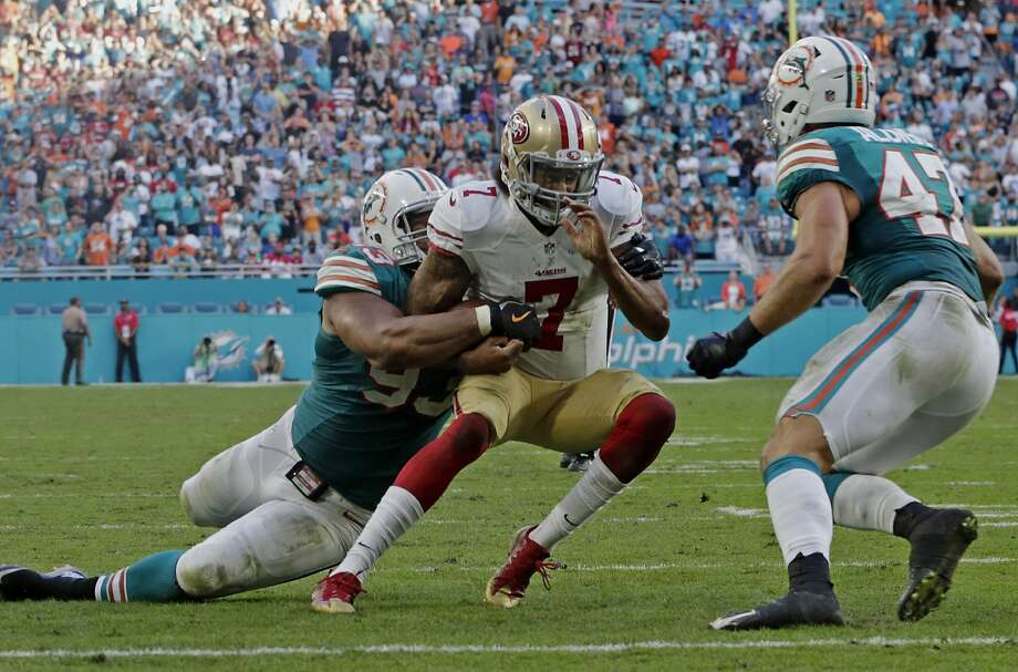 49ers' quarterback Colin Kaepernick is tackled by Miami's Ndamukong Suh, left, at the 2-yard-line on the game's final play to preserve the Dolphins' 31-24 victory. Photo: Lynne Sladky, Associated Press