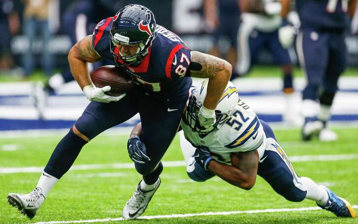 Houston Texans tight end C.J. Fiedorowicz (87) is hit by San Diego Chargers inside linebacker Denzel Perryman (52) after making a catch during the first quarter of an NFL football game at NRG Stadium on Sunday, Nov. 27, 2016, in Houston.