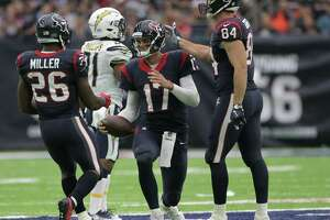 Houston Texans quarterback Brock Osweiler (17) is congratulated after running the ball for a first down against San Diego Chargerson Sunday, Nov. 27, 2016, in Houston.