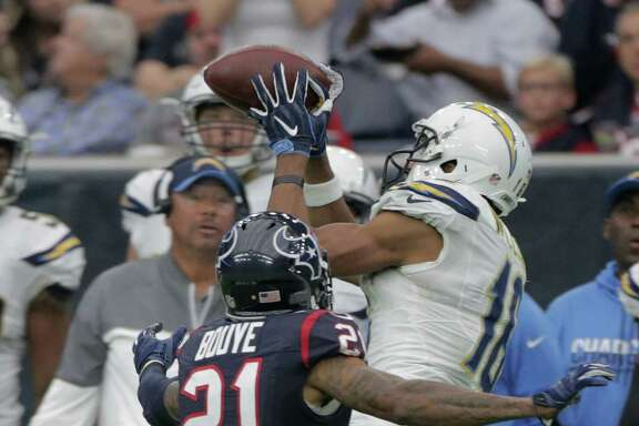 San Diego Chargers wide receiver Tyrell Williams (16) can't hold onto a pass as Houston Texans cornerback A.J. Bouye (21) has his covered in the second quarter on Sunday, Nov. 27, 2016, in Houston.
