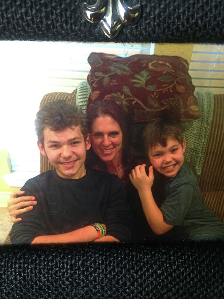 Christine Swan center, with her adopted sons William Swan right, and Jacob Swan right. Courtesy of Department of Family and Protective Services