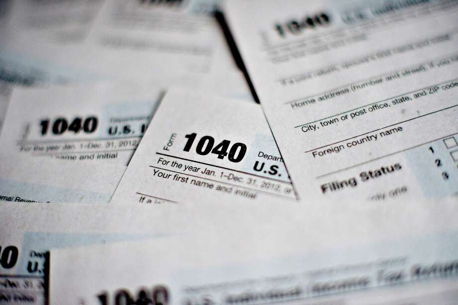 There are free services available on filing taxes for families earning less than $60,000 yearly in San Antonio. Photo: Daniel Acker /Bloomberg / © 2013 Bloomberg Finance LP