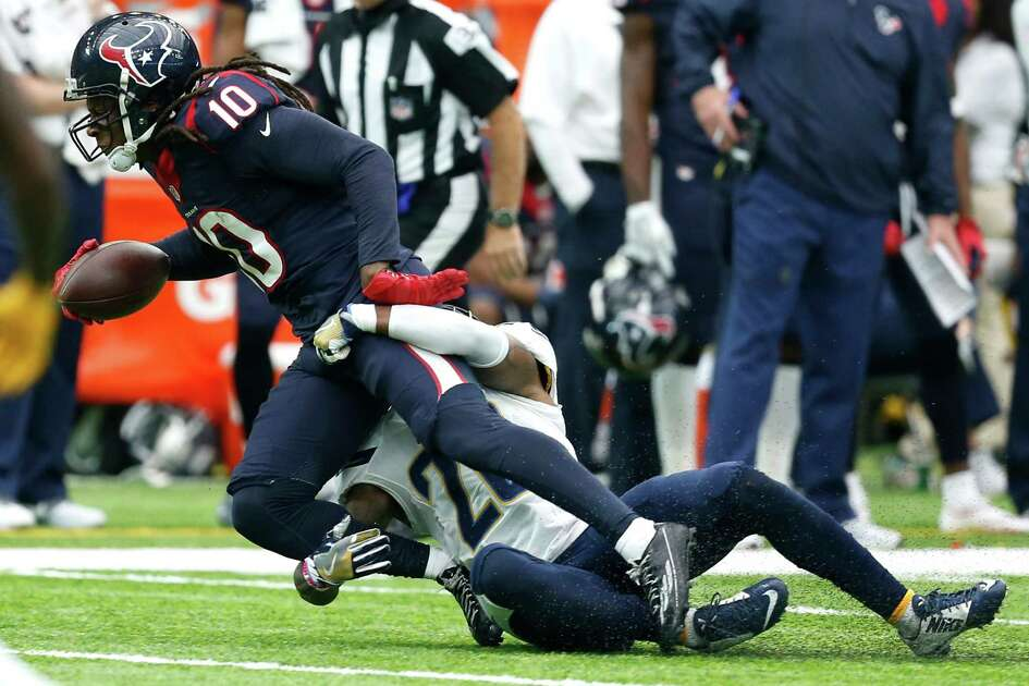Houston Texans wide receiver DeAndre Hopkins (10) is tackled by San Diego Chargers cornerback Casey Hayward (26) during the fourth quarter of an NFL football game at NRG Stadium on Sunday, Nov. 27, 2016, in Houston.