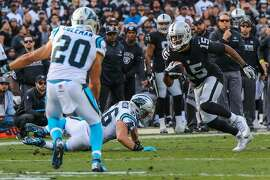 Oakland Raiders football player Michael Crabtree #15 (right), carries the ball down the field in the first half of the game against the Carolina Panthers, at the Oakland Colliseum, in Oakland, California, on Sunday, Nov. 27, 2016.
