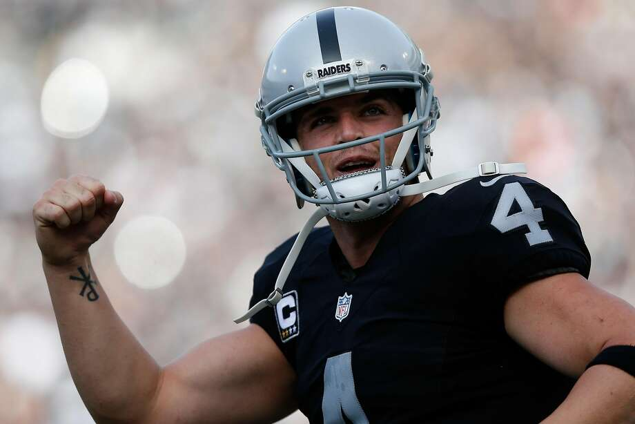 Derek Carr celebrates after a touchdown by Latavius Murray against the Carolina Panthers during their NFL game on Nov. 27, 2016, in Oakland. Photo: Lachlan Cunningham, Getty Images