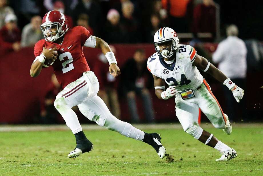Alabama quarterback Jalen Hurts runs the ball against Auburn defensive back Daniel Thomas during the second half of the Iron Bowl NCAA college football game, Saturday in Tuscaloosa, Ala. Photo: Brynn Anderson, Associated Press / Copyright 2016 The Associated Press. All rights reserved.