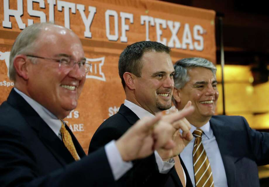 Tom Herman, center, poses with athletic director Mike Perrin, left, and school president Gregory Fenves, right, during a news conference where he was introduce at Texas' new head football coach, Sunday in Austin. Photo: Eric Gay, Associated Press / Copyright 2016 The Associated Press. All rights reserved.