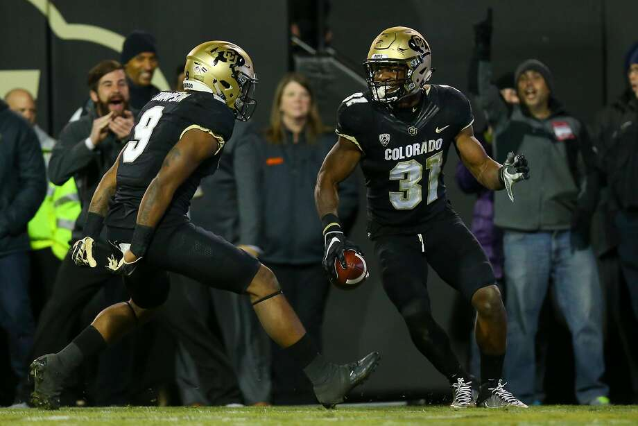 Linebacker Kenneth Olugbode, celebrating his fumble recovery and return for a touchdown Saturday against Utah, is part of a Colorado team that reeled off six straight Pac-12 wins. Photo: Justin Edmonds, Getty Images
