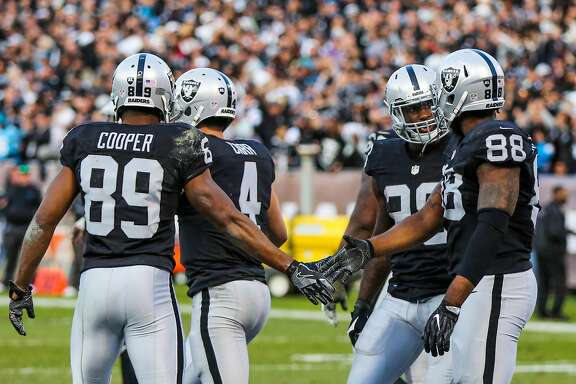 Oakland Raiders Clive Walford, #88 gives a high five to Amari Cooper, #89 (left) after a touchdown during a game against the Carolina Panthers, at the Oakland Colliseum, in Oakland, California, on Sunday November 27, 2016.