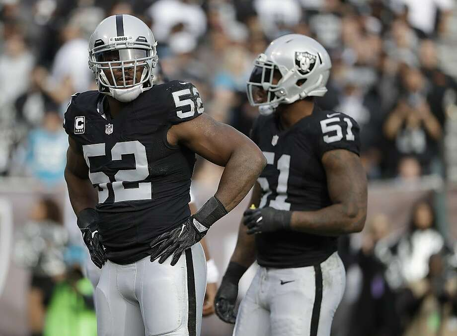Oakland Raiders defensive end Khalil Mack (52) and outside linebacker Bruce Irvin (51) during the first half of an NFL football game against the Carolina Panthers in Oakland, Calif., Sunday, Nov. 27, 2016. (AP Photo/Marcio Jose Sanchez) Photo: Marcio Jose Sanchez, Associated Press