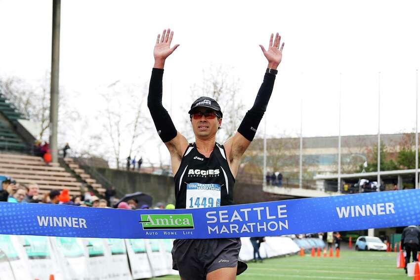 Men's full marathon winner Kota Reichert crosses the finish line during the 2016 Seattle Marathon, Sunday, Nov. 27, 2016.