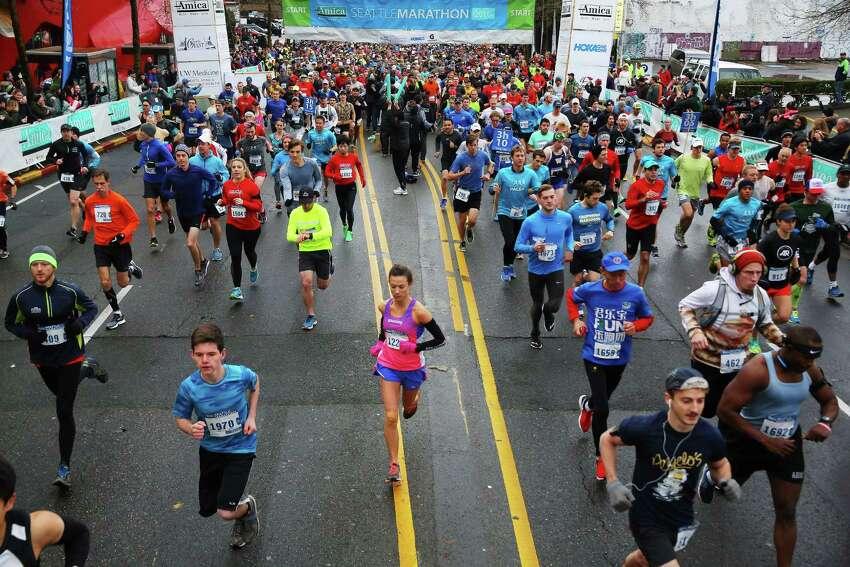 Runners embark on the 2016 Seattle Marathon, Sunday, Nov. 27, 2016.