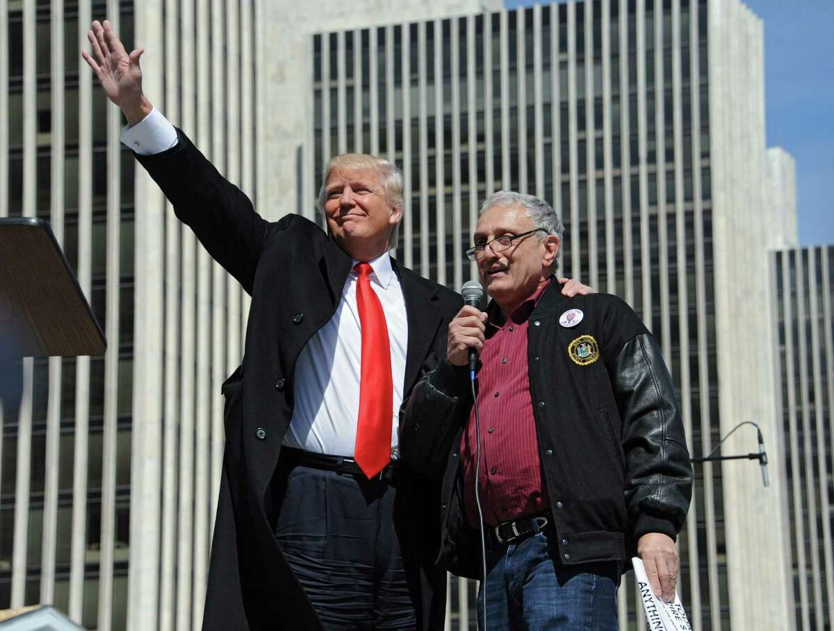 Donald Trump, left, stands with Carl Pasquale Paladino, businessman and political activist from Buffalo, after he spoke to a crowd of Second Amendment advocates rallying against the NY SAFE Act at the Empire State Plaza Tuesday, April 1, 2014, in Albany, N.Y. (Lori Van Buren / Times Union archive)