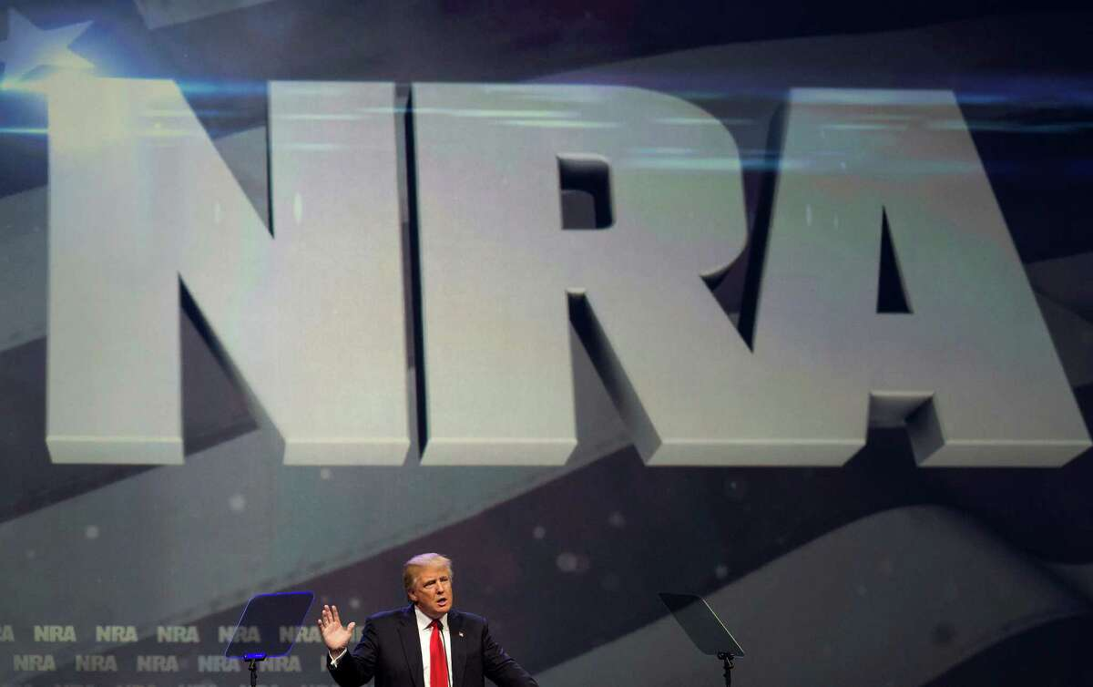 Donald Trump speaks at the annual National Rifle Association convention in Louisville, Ky., May 20, 2016. In a speech that was filled with red meat for conservatives, Trump called for an end to gun-free zones and asserted that Hillary Clinton, his likely opponent in the general election, wanted to abolish the right to bear arms. (Ty Wright/The New York Times) ORG XMIT: XNYT71