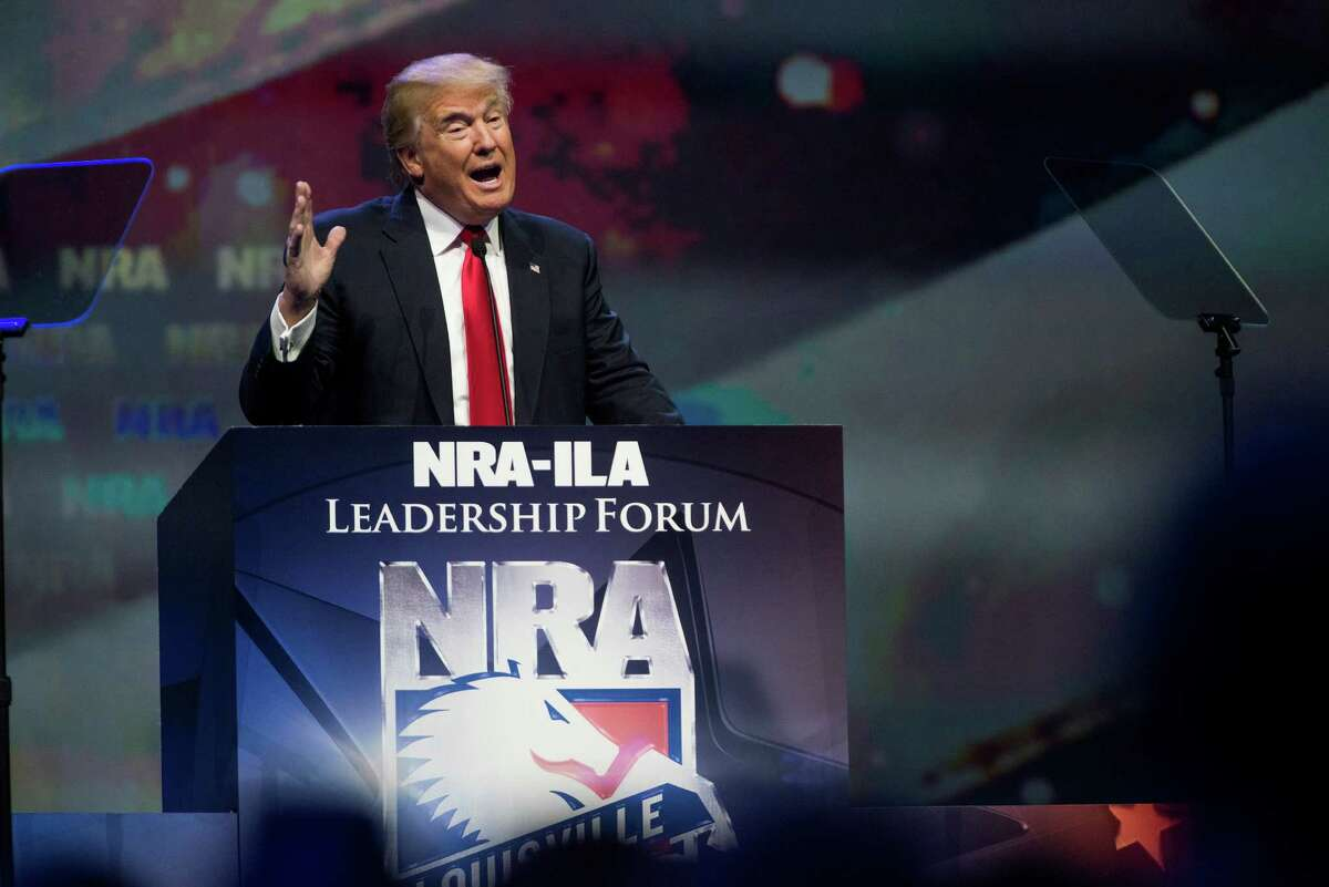 Donald Trump speaks at the National Rifle Association convention in Louisville, Ky., May 20, 2016. In a speech that was filled with red meat for conservatives, Trump called for an end to gun-free zones and asserted that Hillary Clinton, his likely opponent in the general election, wanted to abolish the right to bear arms. (Ty Wright/The New York Times)
