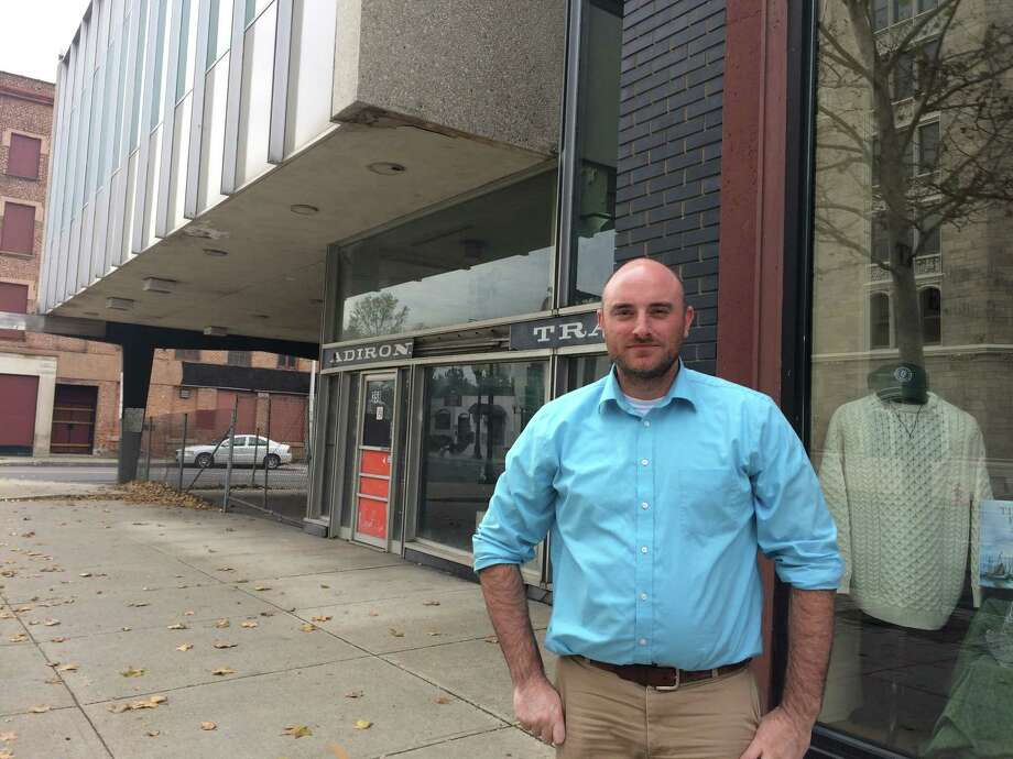 Ryan Mahoney, executive director of the Irish American Heritage Museum, stands outside the museum on Broadway in Albany Nov. 16, 2016. Mahoney siad the museum moved to the Broadway location five years ago because the city's new convention center was supposed to be built next door. But now he said it feels the New York state has abandoned the properties, allowing them to fall into disrepair. (Lauren Stanforth, Times Union)