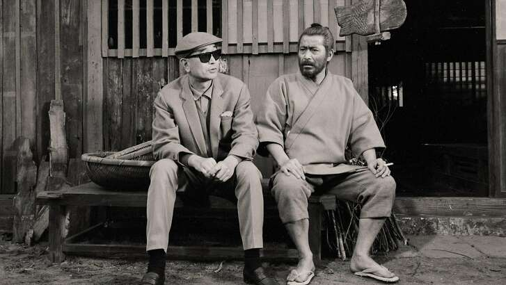 "Actor Toshiro Mifune (right) and director Akira Kurosawa on the set of ""Red Beard"" (1965) in a scene from Steven Okazaki's documentary ""Mifune"" The Last Samurai."""