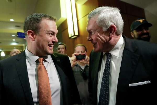 New Texas head football coach Tom Herman, left, talks with former Texas coach Mack Brown following a news conference where he was introduced, Sunday, Nov. 27, 2016, in Austin. (AP Photo/Eric Gay)