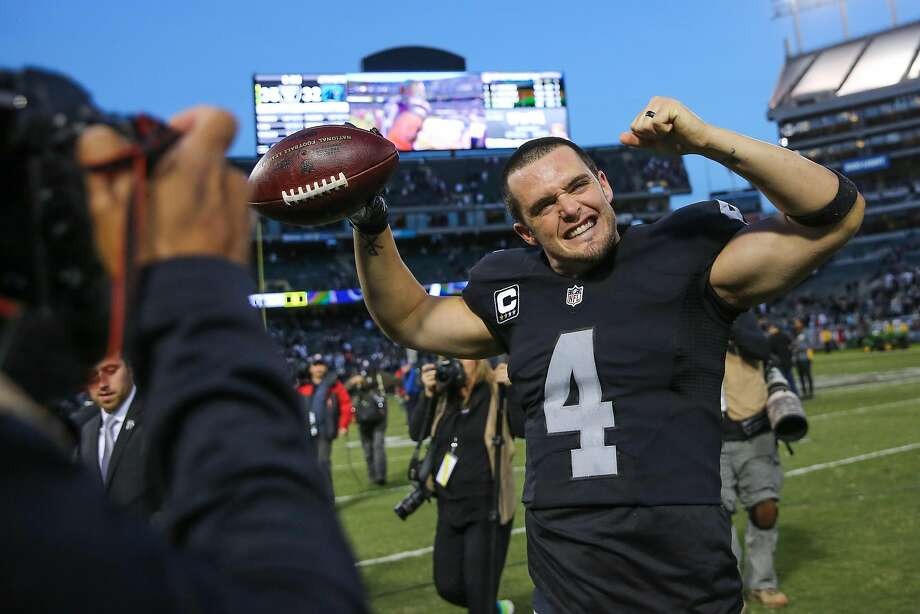 Oakland Raiders quarterback Derek Carr, #4, waves to the crowd at the end of a game against the Carolina Panthers which ended in a Raiders victory, of 35-32,  at the Oakland Colliseum, in Oakland, California, on Sunday November 27, 2016. Photo: Gabrielle Lurie, The Chronicle