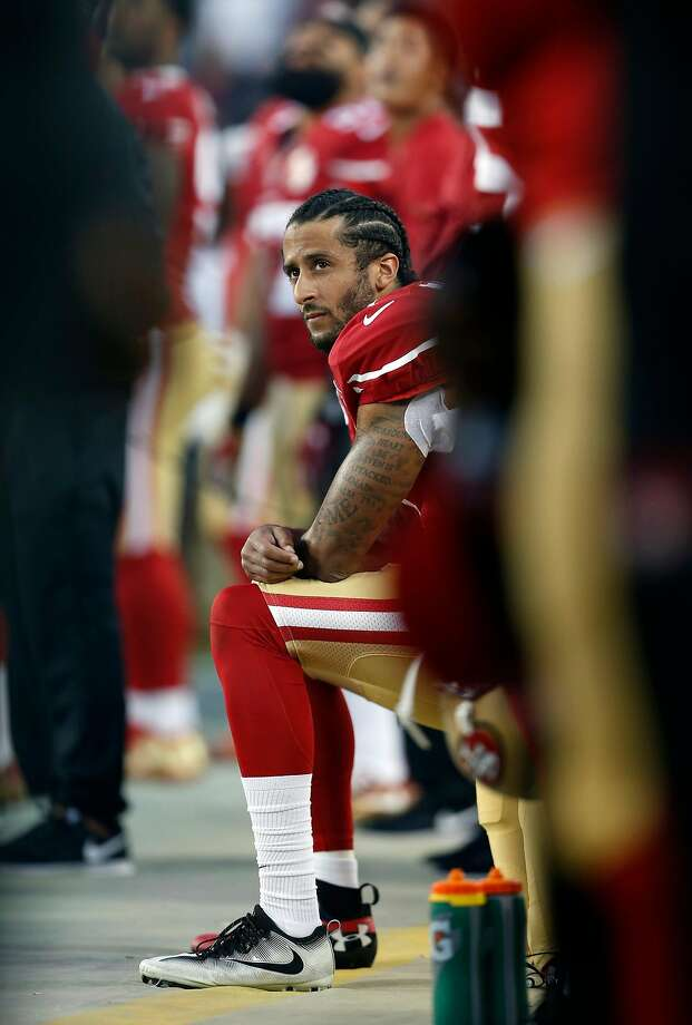 San Francisco 49ers' Colin Kaepernick kneels during National Anthem before playing Los Angeles Rams during NFL game at Levi's Stadium in Santa Clara, Calif., on Monday, September 12, 2016. Photo: Scott Strazzante, The Chronicle
