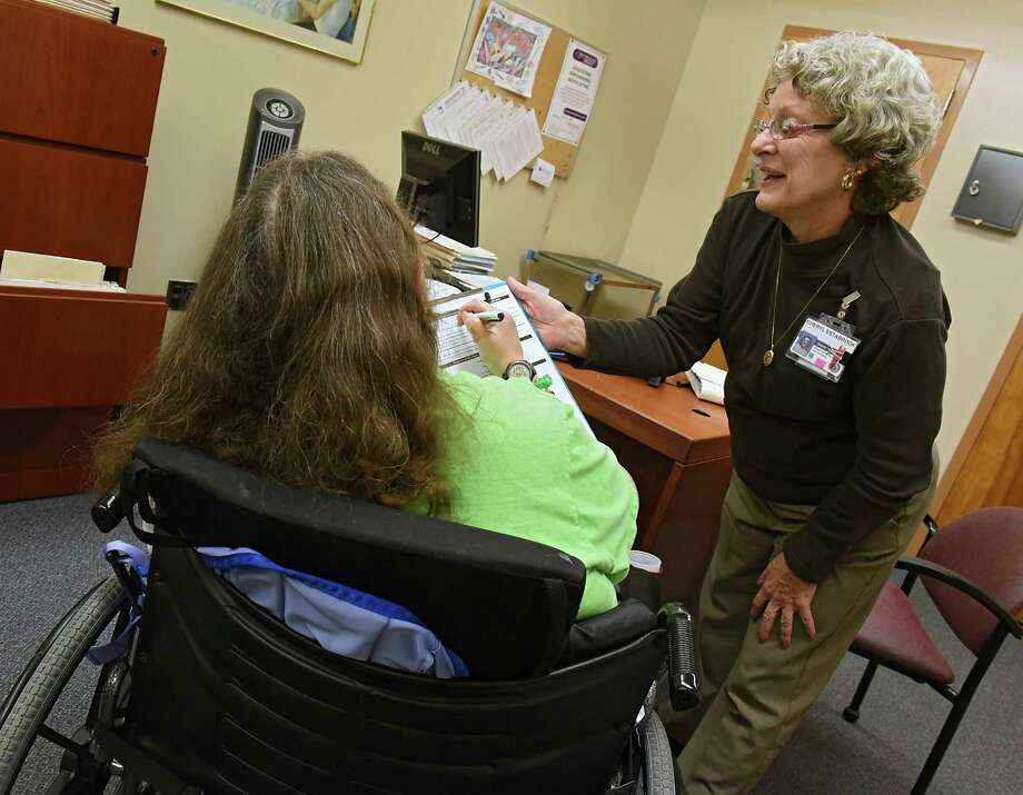 Social worker Cheryl Estabrook, right, helps a resident at the Albany County Nursing Home on Monday, Nov. 21, 2016 in Colonie, N.Y. (Lori Van Buren / Times Union) Photo: Lori Van Buren / 20038864A