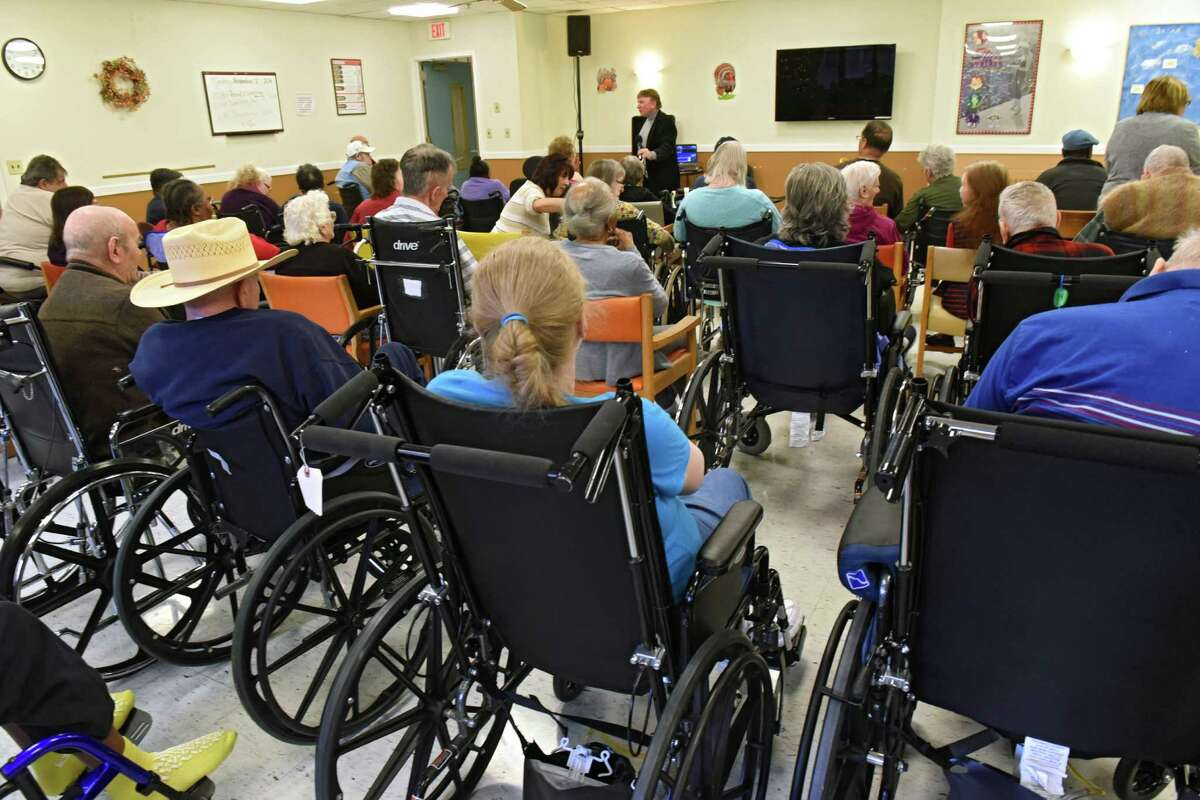 Residents listen to a performer sing in a community room at the Albany County Nursing Home on Monday, Nov. 21, 2016 in Colonie, N.Y. (Lori Van Buren / Times Union)