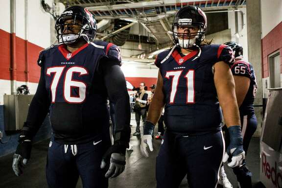 Houston Texans tackle Duane Brown (76) and guard Xavier Su'a-Filo (71) wait to be introduced before an NFL football game against the San Diego Chargers at NRG Stadium on Sunday, Nov. 27, 2016, in Houston.