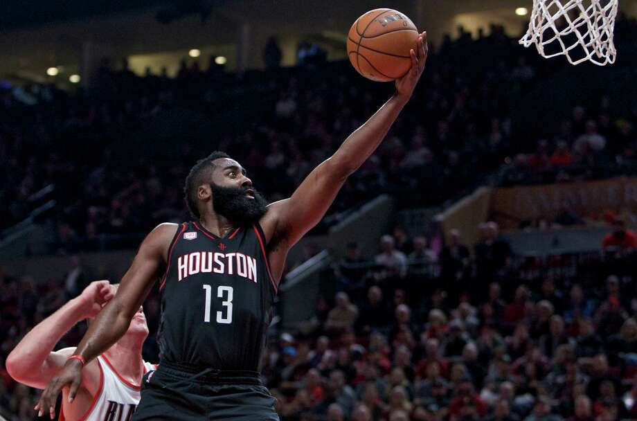 Houston Rockets guard James Harden, right, shoots over Portland Trail Blazers center Mason Plumlee during the first half of an NBA basketball game in Portland, Ore., Sunday, Nov. 27, 2016. (AP Photo/Craig Mitchelldyer) Photo: Craig Mitchelldyer, Associated Press / FR170751 AP