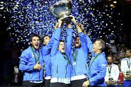 Leonardo Mayer, Juan Martin del Potro, Guido Pella, Federico Delbonis and coach coach Daniel Orsanic celebrate after Argentina defeated Croatia at Zagreb, Croatia, for the South American country's first Davis Cup championship.